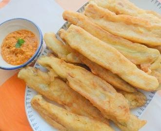 "Breaded ""calçots"" with romesco sauce"